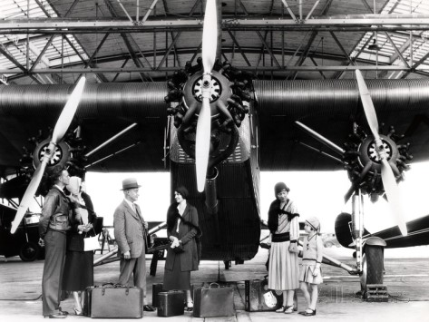 1920s-1930s-passengers-waiting-in-front-of-ford-trimotor-airplane