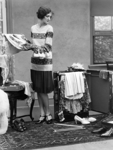 1920s-woman-packing-clothes-for-travel