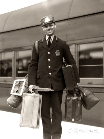 1930s-1940s-man-red-cap-porter-carrying-luggage-bags-suitcases-passenger-railroad-train