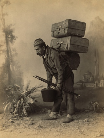 turkish-porter-carrying-luggage-on-his-back-portrait-by-abdullah-freres-ca-1890