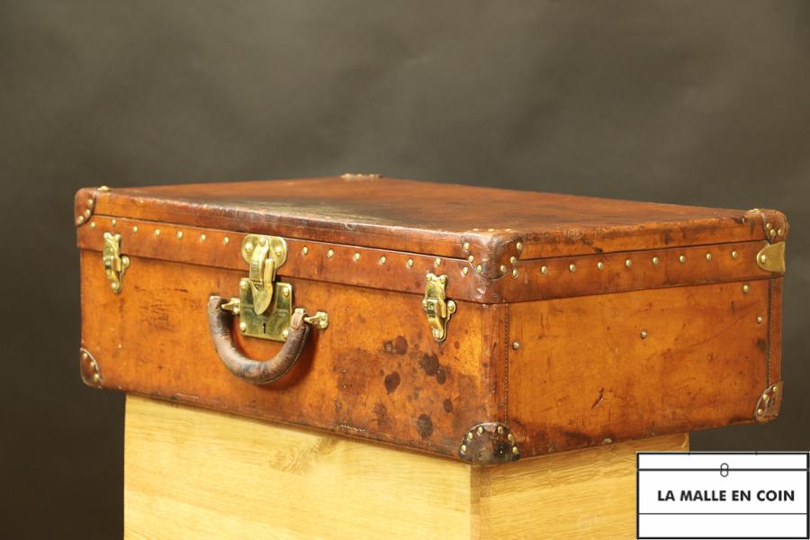 Louis Vuitton leather suitcase DV29